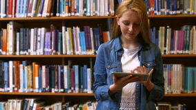 Student studying in a library stock video footage