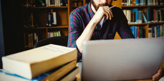 Student studying in library at university Royalty Free Stock Photography