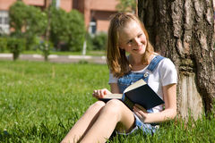 Student Studying On The Grass Royalty Free Stock Photos