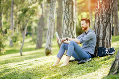 Student studying in park. Student studying outdoors in park Stock Photos