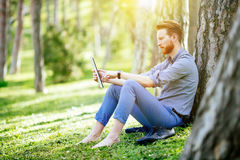 Student studying in park. Student studying outdoors in park Royalty Free Stock Image