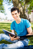 Student studying at the school garden. Young student studying at the school garden Royalty Free Stock Photos