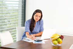Student studying writing research examination living room Royalty Free Stock Photos
