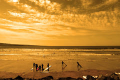 Student surfers glorious sunset beach Royalty Free Stock Image