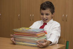 Student is surprised by stack of books Royalty Free Stock Photo
