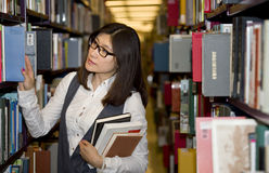 Student surrounded by books Stock Image