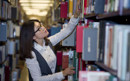 Student surrounded by books Stock Photography