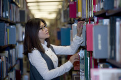 Student surrounded by books Royalty Free Stock Images
