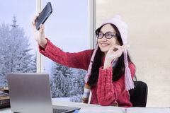 Student with sweater taking selfie Stock Image