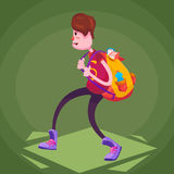 A schoolboy in sneakers comes with a heavy backpack on his back. A student in a T-shirt, jeans and sneakers goes to the side with a heavy backpack on his back Stock Image