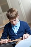 Student and tablet in classroom Stock Images