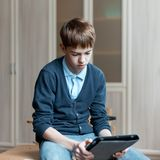 Student and tablet in classroom Stock Photo
