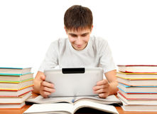 Student with Tablet Computer. At the Desk with the Books on the White Background Stock Image
