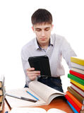 Student with Tablet Computer. At the Desk with many books on the White Background Royalty Free Stock Image