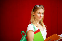 Student with tablet on empty red background Stock Photo
