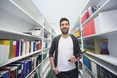 Student with tablet in library Stock Images