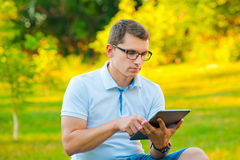 Student with tablet outdoors Stock Photos