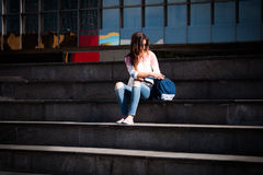 Student take break at stairs Royalty Free Stock Images