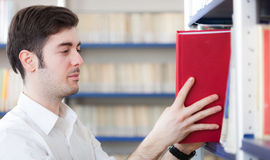 Student taking a book in a library Stock Photo