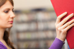 Student taking a book in a library Stock Photos