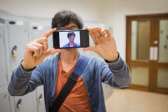Student taking his selfie on smartphone Stock Photos
