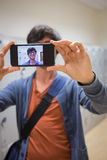 Student taking his selfie on smartphone Royalty Free Stock Photography