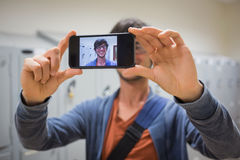 Student taking his selfie on smartphone Royalty Free Stock Images