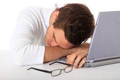 Student taking a nap on his laptop Royalty Free Stock Photography