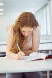 Student taking notes in class Stock Image