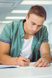 Student taking notes in class Royalty Free Stock Photos