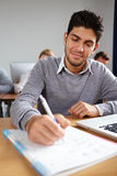 Student taking notes in university Stock Photo