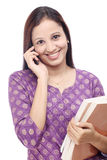 Student talking on cellphone Stock Images