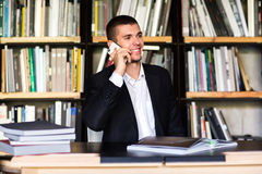 Student talking on the phone in the library. Student in library Stock Images