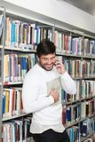 Student Talking on the Phone in Library. At the University Stock Image