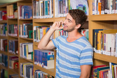 Student talking on the phone in library Stock Image
