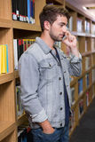 Student talking on the phone in library. At the university Stock Photos