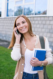 Student talking on phone and looking away. Student talking on her phone and looking away royalty free stock photography