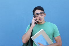 Student talking on the phone with surprise.  Stock Photography