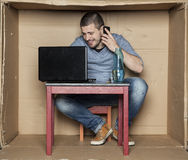 Student talking on the phone and writing e-mail Stock Images