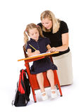 Student: Teacher Behind Student Helping With Homework Royalty Free Stock Photography