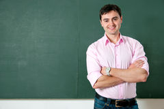 Student or teacher at the blackboard Royalty Free Stock Photos