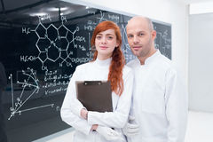 Student and teacher at blackboard Stock Photo