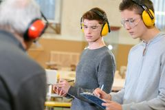 Student and teacher in carpentry class. Capentry Royalty Free Stock Photography