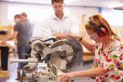 Student And Teacher In Carpentry Class Using Circular Saw Royalty Free Stock Photography