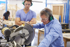 Student And Teacher In Carpentry Class Using Circular Saw Royalty Free Stock Photos