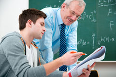 Student with a teacher in classroom stock photography