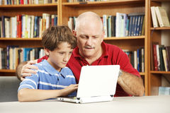 Student and Teacher on Computer Stock Images