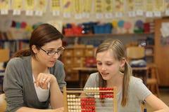 Student teacher explained a math question. Teacher says a student in the school a math problem stock photos