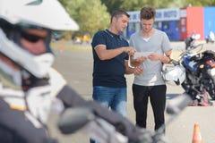 Student and teacher motorbike riding school Royalty Free Stock Photo
