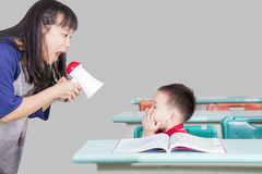 Student and teacher screaming in the classroom. Child and teacher screaming in the classroom stock images